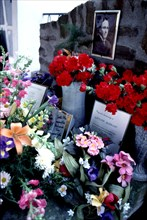 Flower-filled tomb in the cemetery of Cotlliure with the picture of Antonio Machado (1875-1939), ?