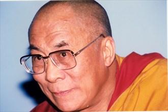 Dalai Lama of Tibet (1935 -), spiritual leader of the Buddhist religion.