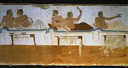 Banquet in which a deceased participates. Detail of a painting in the Jumper Tomb at Paestum.