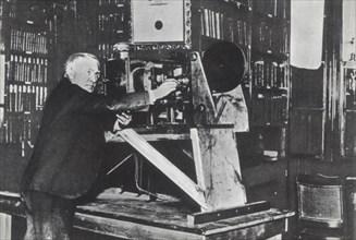 Thomas Alva Edison (Milan, Ohio, 1847-West Orange, New Jersey, 1931) in his lab, inventor of the ?