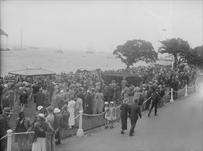 Spectators watching yachts at Cowes, Isle of Wight. Creator: Kirk & Sons of Cowes.