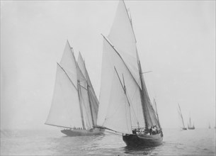 Unknown yawl and schooner under sail. Creator: Kirk & Sons of Cowes.