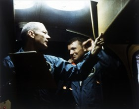 Buzz Aldrin and Neil Armstrong in quarantine, Apollo 11 mission, July 1969. Creator: NASA.