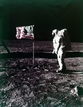 Buzz Aldrin stands next to the American flag on the surface of the Moon, July 1969. Creator: Neil Armstrong.
