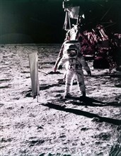 Buzz Aldrin deploys solar wind collector on the surface of the Moon, Apollo 11 mission, July 1969.  Creator: Neil Armstrong.