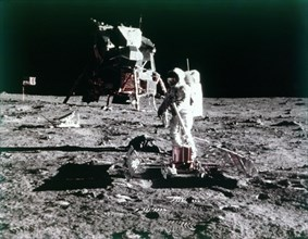 Buzz Aldrin sets up the seismic experiment, Apollo II mission, July 1969.  Creator: Neil Armstrong.