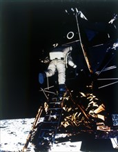 Buzz Aldrin descends from the Lunar Module, Apollo II mission, July 1969. Creator: Neil Armstrong.