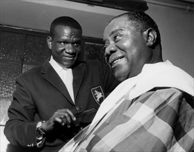 Louis Armstrong having haircut in Hammersmith, London, 1962.