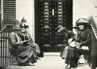 Suffragettes waiting on the doorstep of Sir Edward Carson's London home, 6 April 1914, (1947).
