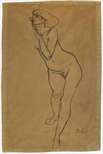 Femme nue debout.