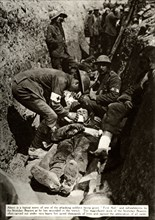 Wounded soldier being treated in the trenches, Battle of the Somme