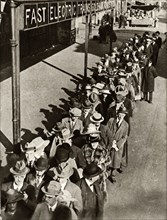 Passengers waiting at Goldhawk Road Station in London during the railway strike,1919