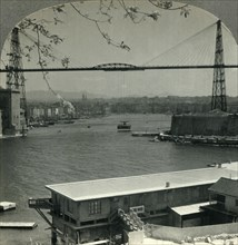 'The Transporter Bridge and Entrance to Old Harbor, Marseilles, France', c1930s. Creator: Unknown.