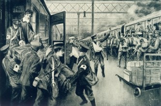 'Wounded in War Arriving at Waterloo Station, London, as an Outward Troop Train Leaves', 1915. Creator: Unknown.