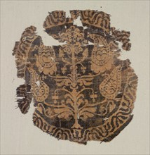 Roundel with curvilinear palmette tree, from a tunic, 600-850. Creator: Unknown.