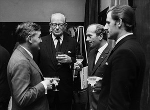 Walter Hayes, Patrick Hennesey, Colin Chapman, Graham Hill. Creator: Unknown.