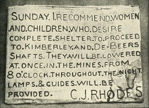 'Placard Erected by Mr. Rhodes', 1900. Creator: Hancox.