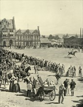 'Scene in Pretoria Square, June 5: Waiting for the Entry of Lord Roberts and his Army', 1901. Creator: A Pearse.