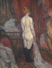 Woman before a Mirror, 1897. Creator: Henri de Toulouse-Lautrec.