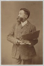 Three-quarter Length Portrait of Thomas Nast Holding Palette and Brush, ca. 1888.