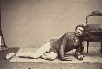 [Man in Chainmail Tunic Posing as a Dying Soldier], ca. 1863.