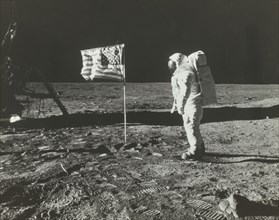 Buzz Aldrin on the Moon with the American Flag, 1969.