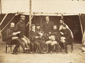 Group Portrait: (L-R) Col.Yule P.W.D., Major Jones A.D.C., Mr. Walters, Captain Stanley A.D.C., Captain Baring A.D.C., Captain Roberts V.C.D.A.Q.M.G., Captain Hills V.C. A.D.C. and Sir E. Campbell Bar...