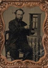 Seated Man Demonstrating Vertical Sliding Window Model, late 1850s-60s.