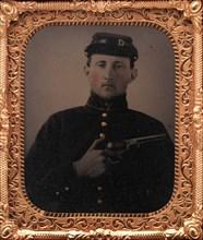 Union Soldier with Colt Revolver, in Studio, 1861-65.