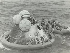 Astronauts in Lifeboat After Apollo 11 Splashdown, 1969.