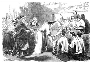 Holy Thursday - the Pope washing the feet of poor priests