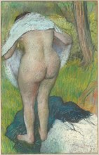 Young Woman Dressing Herself