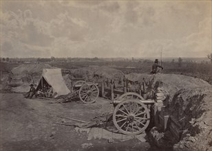 Rebel Works in Front of Atlanta, GA, No. 4, 1864. Union soldier sits on earthworks with a view of the city
