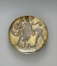 Plate Depicting a Female Figure Riding a Fantastic Winged Beast, Iran, probably 8th century.