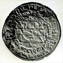 Coin, present-day Uzbekistan, dated A.H. 374/ A.D. 983-84.