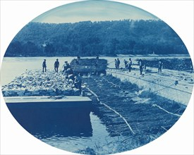 Construction of Rock and Brush Dam, Low. Water. 1891, 1891.