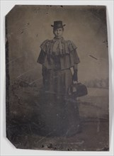 Tintype of a woman carrying a medical bag,1890s. Creator: Unknown.