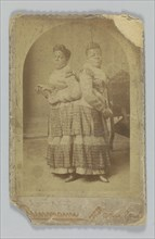 Albumen print of Millie and Christine McCoy, 1880s -1890s. Creator: Charles Eisenmann.