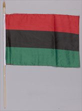 Pan African flag used at the Million Man March 20th Anniversary, 2015. Creator: Unknown.