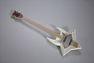 Bootsy Collins Space Bass guitar owned by Bootsy Collins, July 2002. Creator: Washburn Guitars.