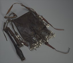 Leather bag with tools, whistles, and shells, 20th Century. Creator: Unknown.