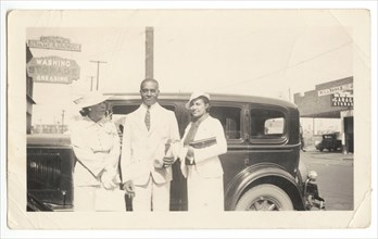 Photographic print of Mr. and Mrs. Jackson and another woman in front of car, 1926. Creator: Unknown.