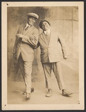 Photograph of two men linking arms, 1910s - 1920s. Creator: The Bell Studio.