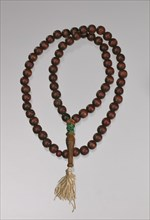Wooden prayer beads owned by Suliaman El-Hadi, late 20th century. Creator: Unknown.