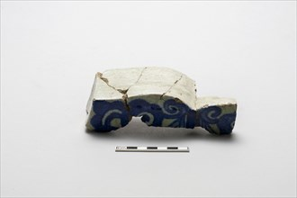 Fragment of an underglaze cobalt-blue-painted wall tile, (18th century?). Creator: Unknown.