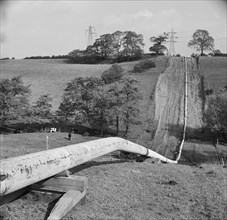 Mersey oil pipeline..., showing the pipeline after the welders have passed..., 24/09/1967. Creator: John Laing plc.