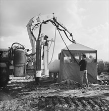 A view of welding taking place along the Fens gas pipeline, Norfolk, 10/08/1967. Creator: John Laing plc.