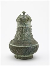 Lidded ritual wine container (hu) with masks and dragons, Late Shang dynasty, c13th century BCE. Creator: Unknown.