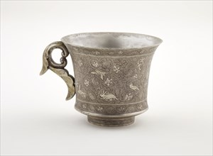 Wine cup with ring handle, birds, animals, and grape vines, Early Tang dynasty, late 7th century. Creator: Unknown.