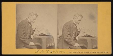 Portrait of Increase Allen Lapham (1811-1875) - Examining the Wisconsin Meteorite, Circa 1868. Creator: Hugo Broich.